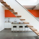 A Kitchen and a Sculptural Staircase