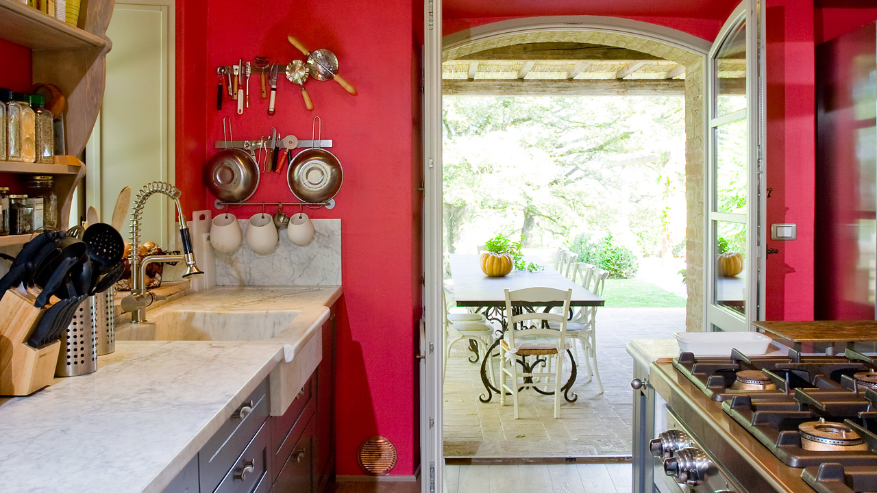 red farmhouse kitchen tuscany marble
