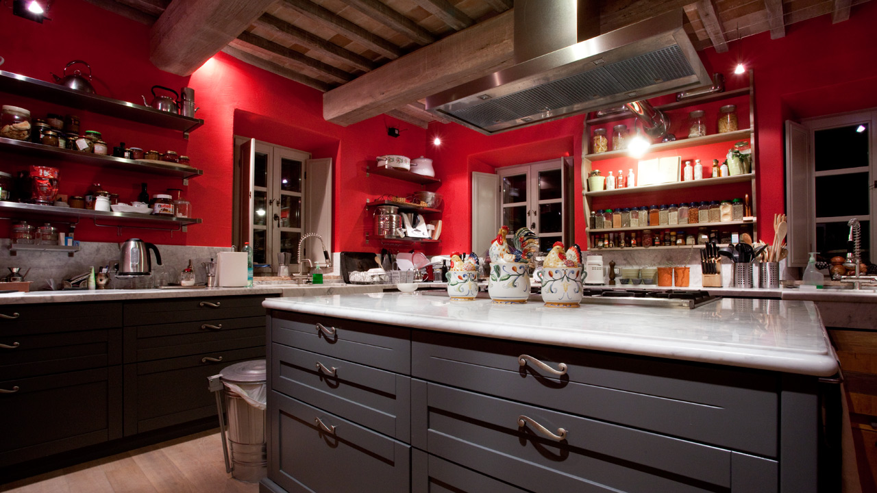 red farmhouse kitchen tuscany night