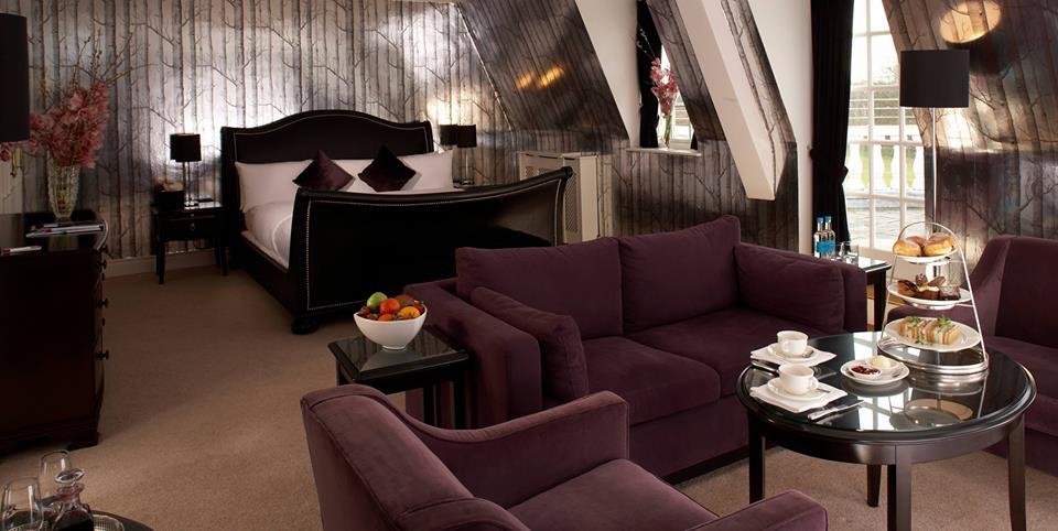 bedroom with woods wallpaper