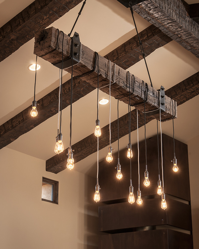 contemporary-hanging-lighting-and-wood-barn-beams