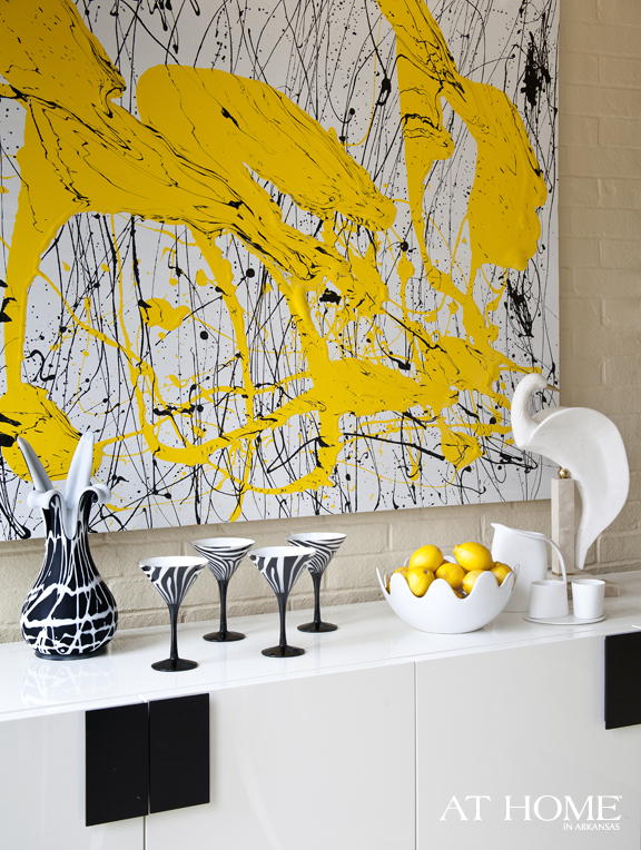yellow art in the dining room
