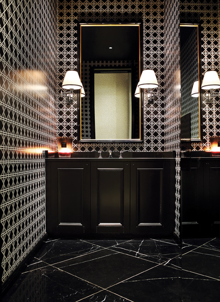 Black marble floors and intense geometric walls for Dark bathroom wallpaper