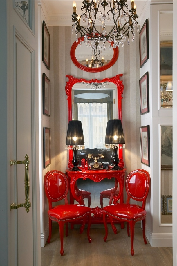 painted red chairs and mirror