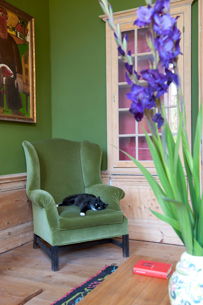 green walls and armchair