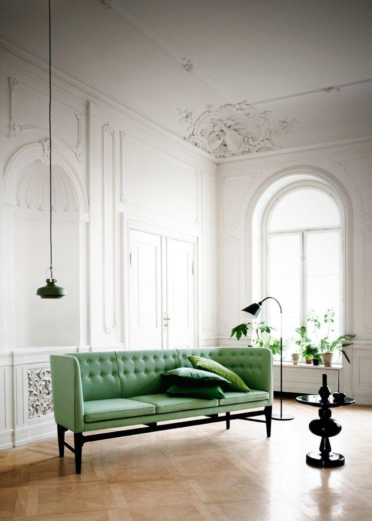 Mint green sofa, via Interiors by color