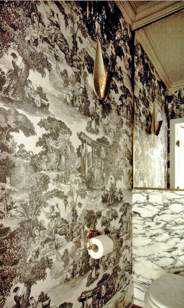 marble and black and white oile bathroom