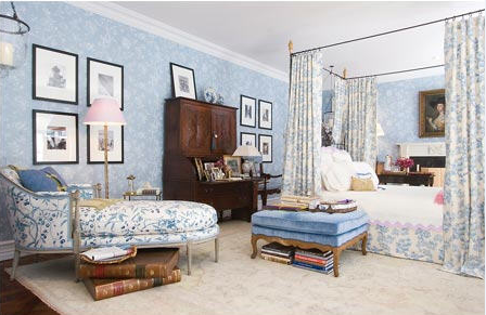 An antique painted French chaise fills up the corner.