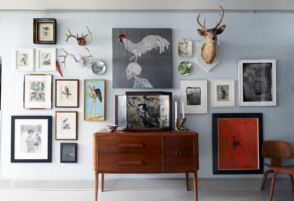 Audubon prints, an embroidery piece by Angelo Filomeno, and photographs by Abranowicz, Victor Schrager, Tom Baril, and George Tice, among others, line the walls of the gallery; the cabinet was found at auction.