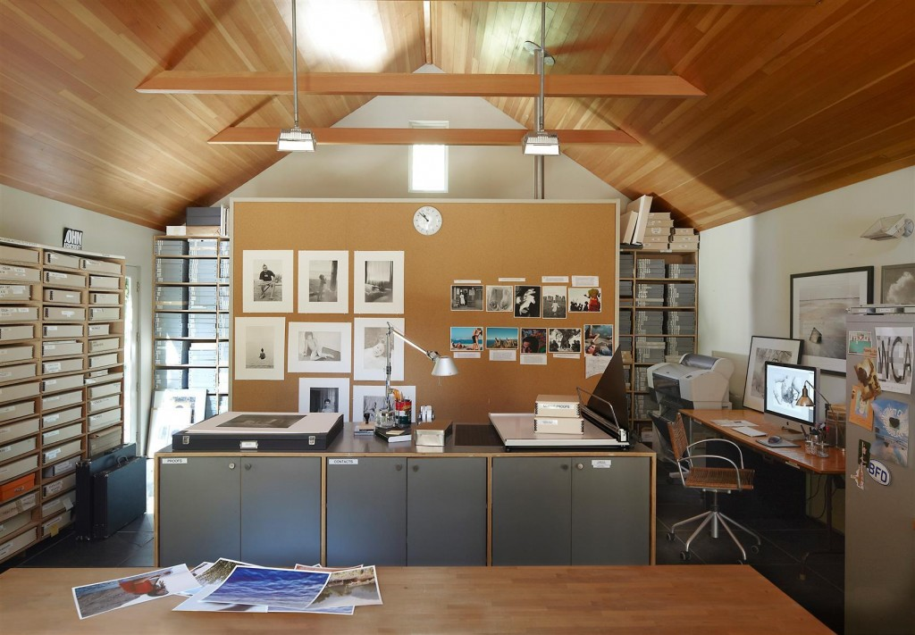 A custom-made cabinet and desk in the office; the table lamp is by Artemide, and the ceiling is stained fir.