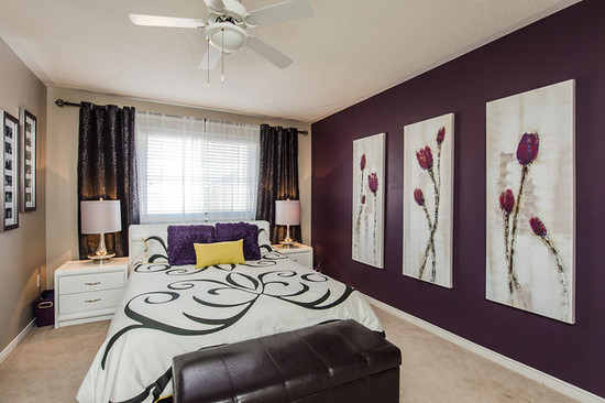 Purple flowers in the bedroom interiors by color for Purple feature wallpaper living room