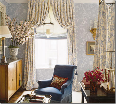 curtains and roman shades with blue tape trim