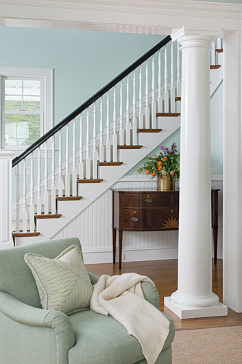 mint armchair and staircase