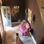 A Chocolate Brown Entryway with Pink Sofa