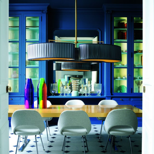 Contemporary blue dining room with recycled elements