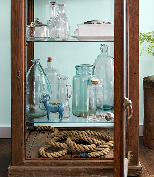 glass cabinet with vases inside