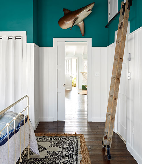 country bedroom with teal colored accents