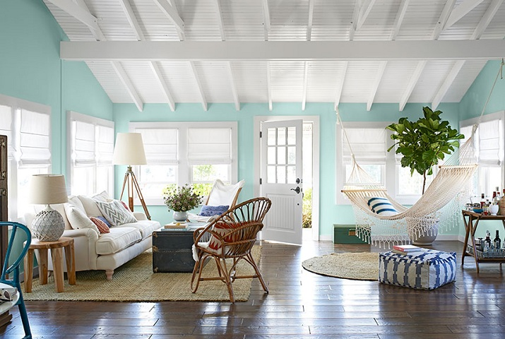 White Painted Rafters And Aqua Walls Living Room