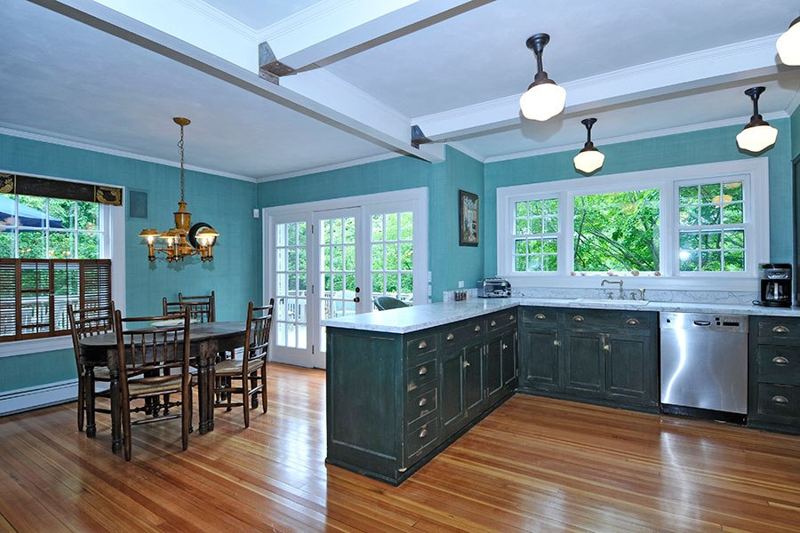 Teal green two toned colored kitchen in a traditional style, a home in