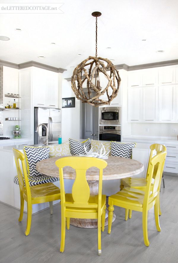 Modern White Kitchen with Yellow Chairs