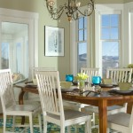 Green Dining Room with White Chairs