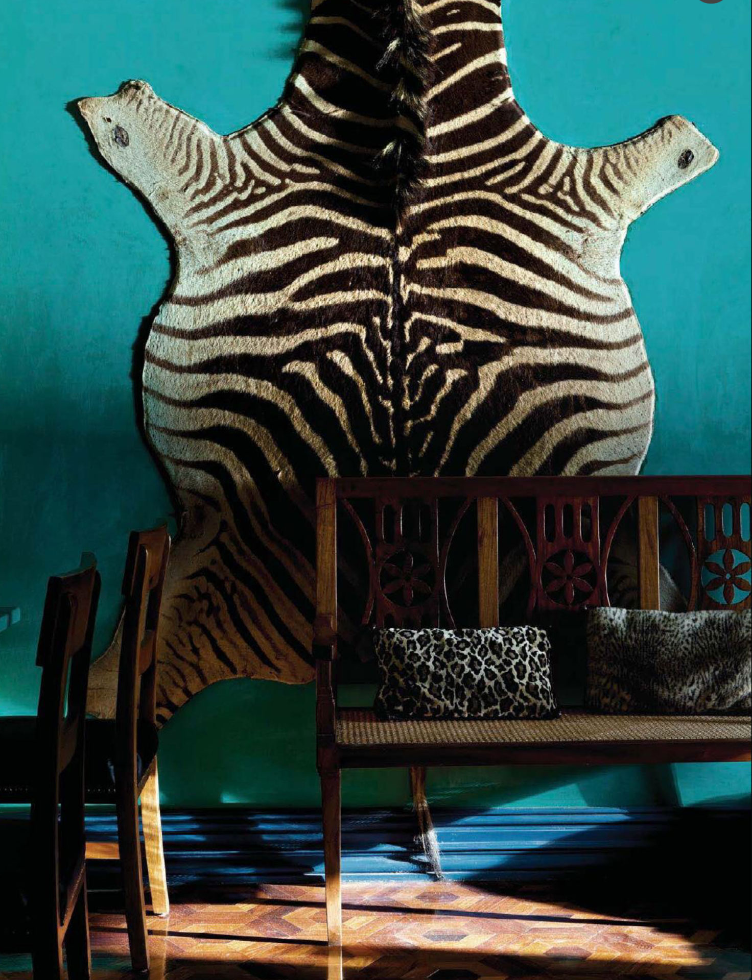 zebra-print-rug-on-turquoise-wall