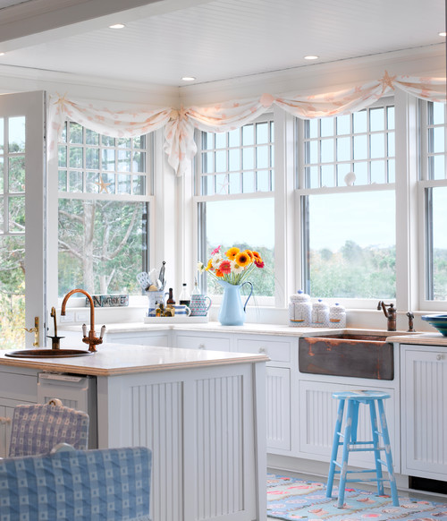 White coastal home decor with pastel blue accents