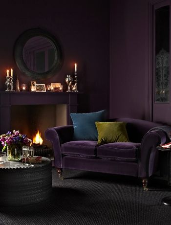 Aubergine sofa and walls