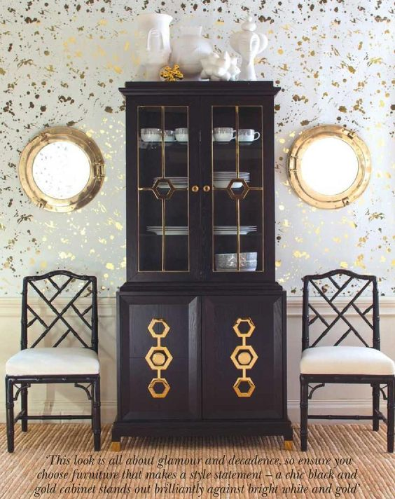 Ideal for storage and display, this piece is both practical and stylish. Turner vitrine with cabinet, f2,990; Chippendale chairs, £695 each; Drip wallpaper in gold and white, f300 per roll; accessories, from a selection; all Jonathan Adler.
