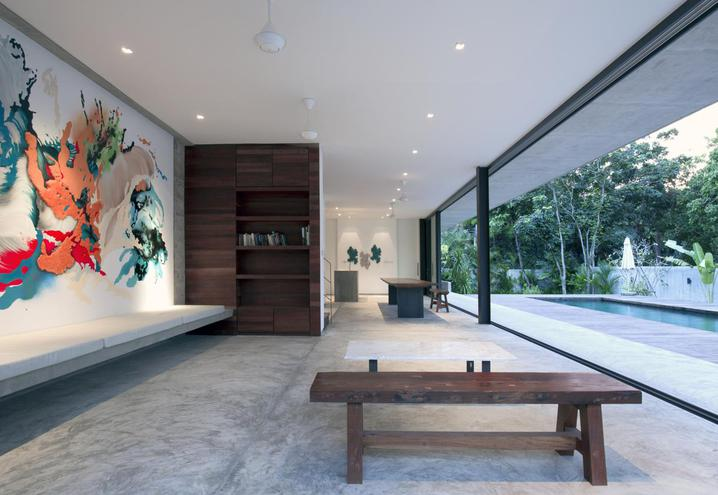MICRO-CONCRETE FLOORS CHARACTERISE THE AIRY, OPEN LIVING AREA ON THE GROUND FLOOR OF BANG SARAY HOUSE. SET ON THE COAST OF THAILAND, THE VILLA HAS BEEN DESIGNED BY ARCHITECTKIDD STUDIO IN A MODERNIST STYLE