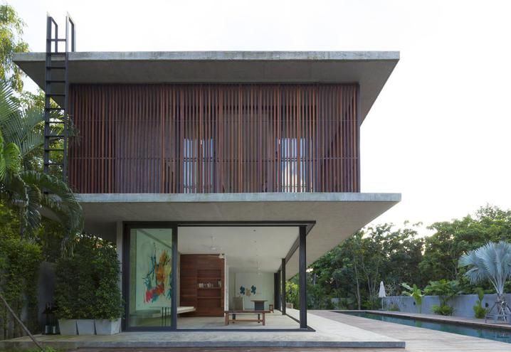 BANG SARAY HOUSE IS MAINLY BUILT FROM WOOD, GLASS AND CONCRETE. THE VILLA, DESIGNED BY ARCHITECTKIDD STUDIO, IS LOCATED NEAR THE EAST COAST OF THE GULF OF THAILAND