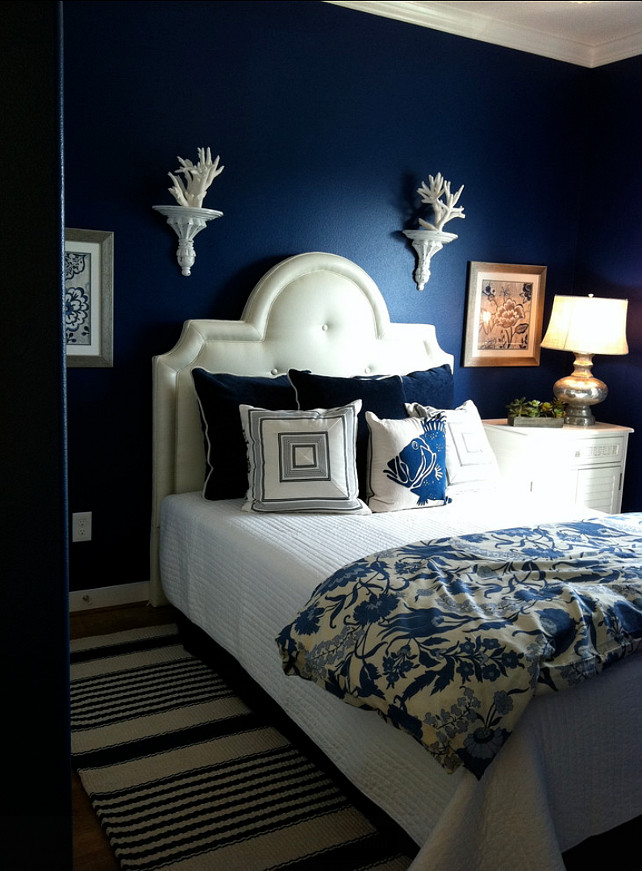 Benjamin Moore Admiral Blue painted walls in the bedroom for a moody, dreamy, beachy vibe.