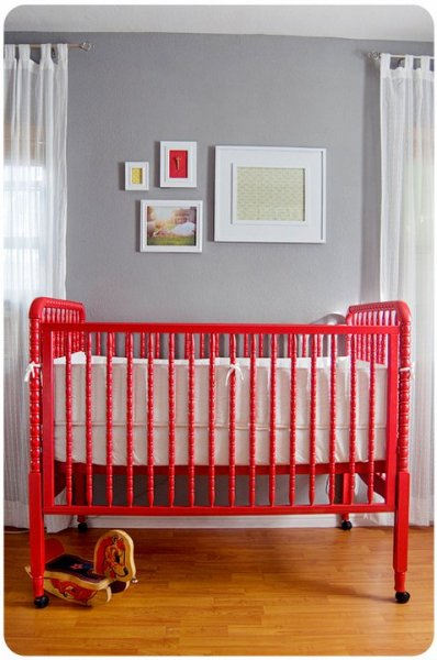 Vintage style red crib with gray walls nursery