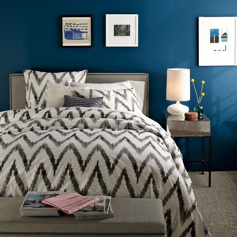 Modern/contemporary bedroom with accent wall painted in Benjamin Moore Marine Blue.