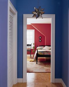 Hallway painted in Benjamin Moore Southern Belle. Looks great with a white trim.