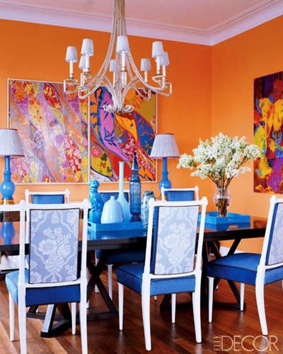 Blue and orange, tradition and tropics with walls painted in Benjamin Moore Calypso Orange