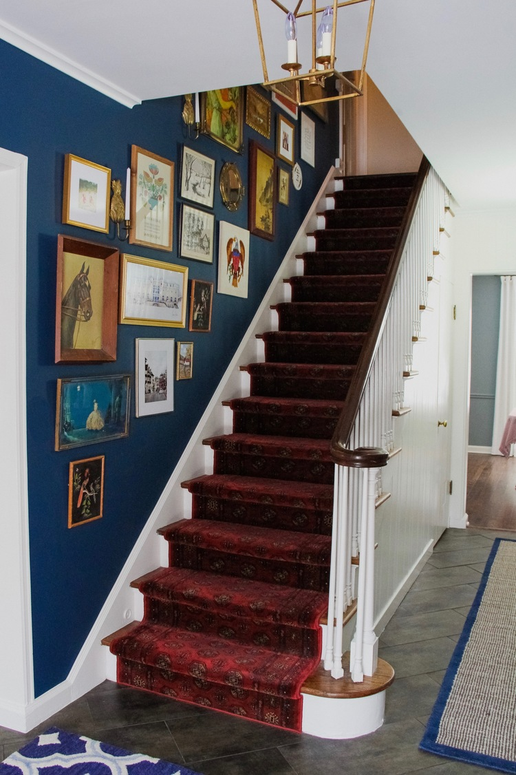 Benjamin Moore Washington Blue CW-630 painted stairwell with red carpet.