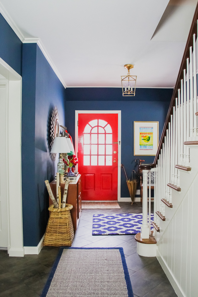 Entrance with walls painted in Benjamin Moore Washington Blue and red painted door.