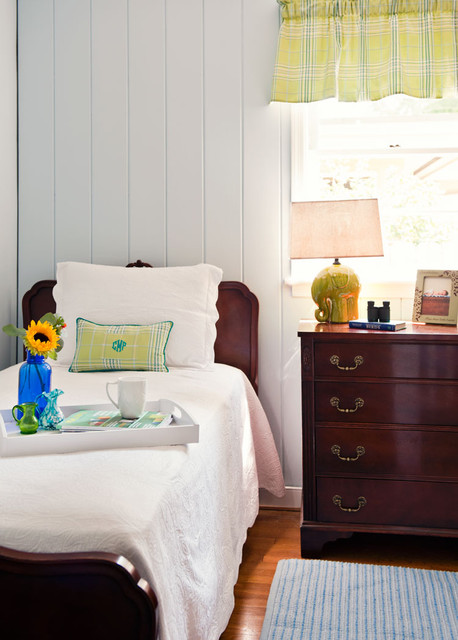 Traditional antique bedroom with walls painted in Benjamin Moore's Sweet Bluette.
