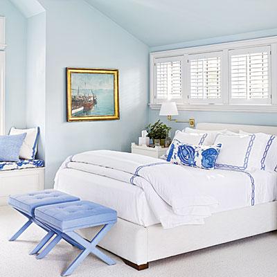 Soothing blue coastal styled bedroom with walls painted in Benjamin Moore's Sweet Bluette.