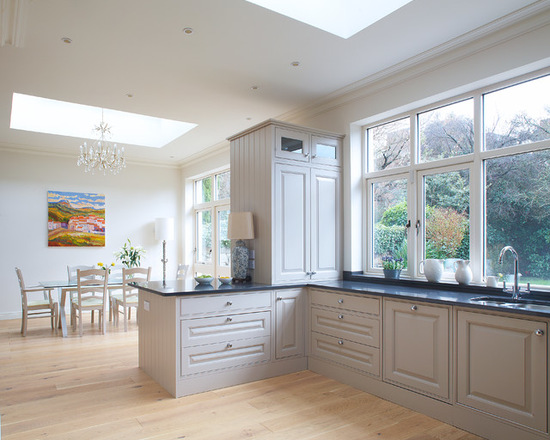Traditional eat-in kitchen in Dublin with an undermount sink, beaded inset cabinets and grey cabinet. Elephants Breath by Farrow and Ball Paint on cabinet. via Optimise Design