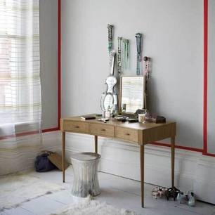 Farrow & Ball Elephant's Breath looks amazing with the red accents on the walls.