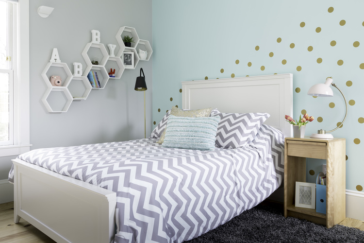 Sherwin Williams Tame Teal feature wall and white and gray chevron duvet