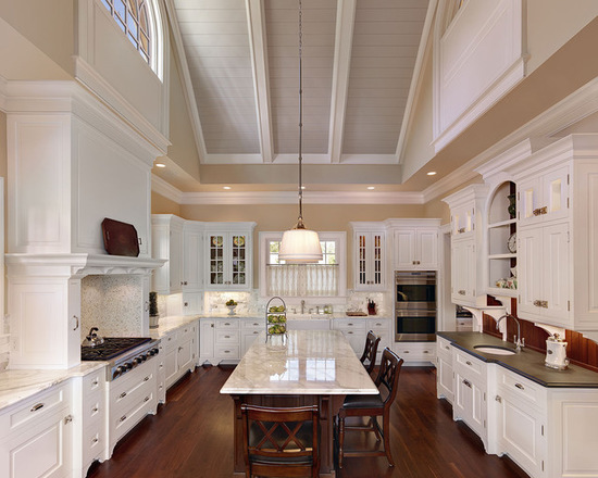Traditional u-shaped kitchen. In this space the ceiling has been painted in Farrow & Ball Elephant's Breath, while the walls are painted Savage Ground by Farrow and Ball and the kitchen cabinets in white. via Christopher A Rose AIA, ASID