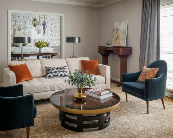 Elephant's breath walls, bone sofa, with blue, orange and grey accents. Transitional living room in San Francisco via John K. Anderson Design