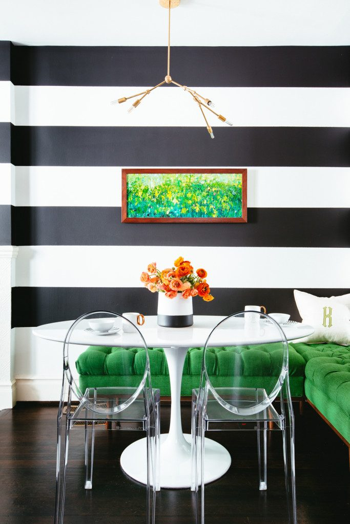 Noz Nozawa of Noz Design created a dramatic backdrop for a glam breakfast nook using stripes in different finishes. Kelly Green settee. via Colin Price Photography