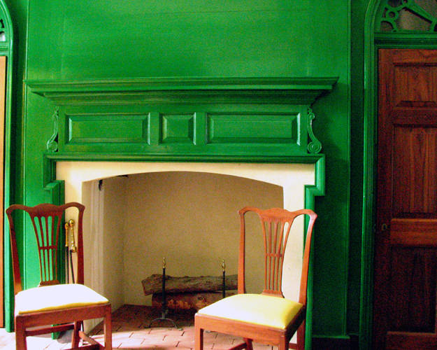 Historical home wall and fireplace painted in a bright green similar to Sherwin WIlliams Jolly Green