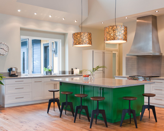 Contemporary l-shaped eat-in kitchen in Vancouver with an undermount sink, recessed-panel cabinets, green cabinets, quartz benchtops, grey splashback, glass tile splashback and panelled appliances. Paint color similar to Dulux Green Paw Paw - Via Stuart Wood Joinery