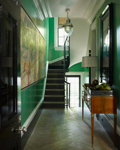 kelly Green painted walls in the entrance and staircase. via Elle decor
