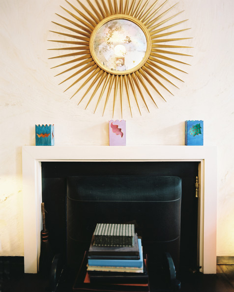 A gold starburst mirror above a fireplace Details: Beige-White Eclectic-Modern Living Room, Multicolored Eclectic-Modern Decor